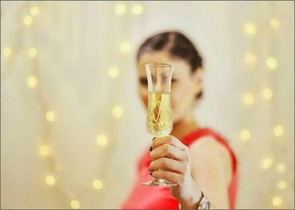 woman toasts with Champagne